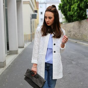 Look off shoulder dress X jeans X hole pattern jacket X Streetstyle from Würzburg von clean_couture