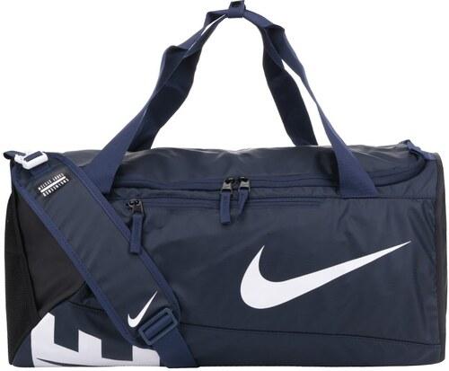 Tmavě modrá unisex sportovní voděodolná taška s potiskem Nike - Glami.cz b40be186ee