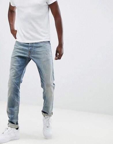 5ff2427d9e2 Diesel Tepphar slim carrot fit distressed jeans in 084UK - Blue ...
